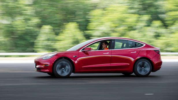 FILE PHOTO: IIHS media relations associate Young drives a Tesla Model 3 at IIHS-HLDI Vehicle Research Center in Ruckersville, Virginia