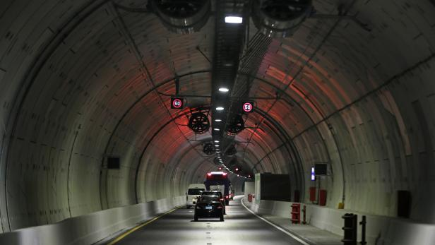 """Cars drive through """"Tahia Masr""""  tunnel which passes under the Suez Canal, in Ismailia"""