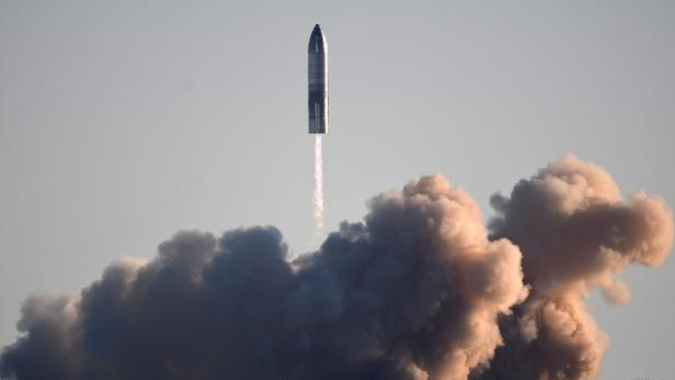 FILE PHOTO: SpaceX launches its first super heavy-lift Starship SN8 rocket during a test from their facility in Boca Chica,Texas