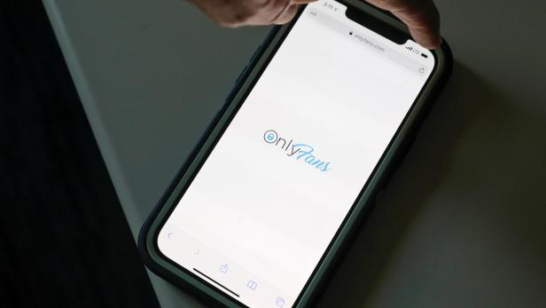 The logo for OnlyFans is seen on a device in this photo illustration in Manhattan, New York City