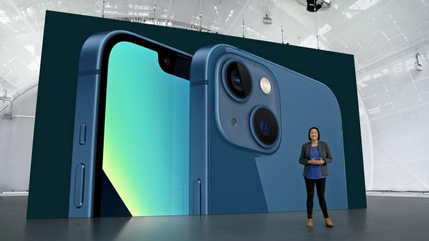 Apple's Kaiann Drance showcases the new iPhone 13 during a special event