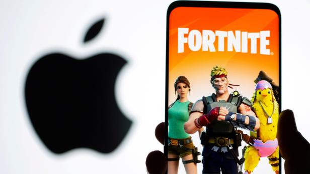 FILE PHOTO: Fortnite graphic and Apple logo displayed in illustration