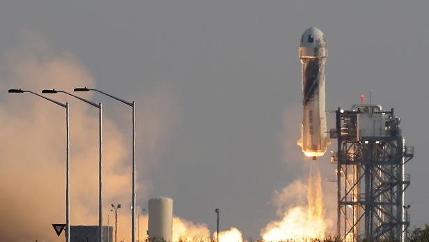 Billionaire businessman Jeff Bezos is launched with three crew members aboard Blue Origin's New Shepard rocket