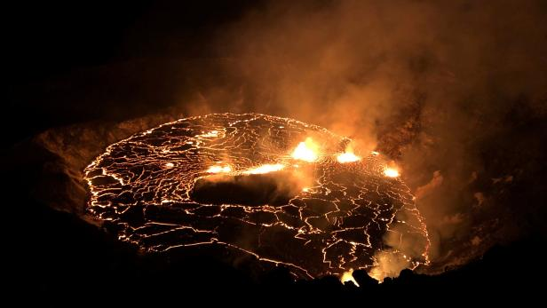 A rising lava lake is seen within Halema'uma'u crater during the eruption of Kilauea  volcano
