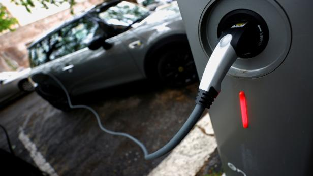 FILE PHOTO: FILE PHOTO: An electric car is plugged in at a charging point for electric vehicles in Rome